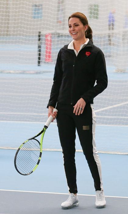 The Duchess, who is Patron of the Lawn Tennis Association, was dressed sporty for her visit to the National Tennis Centre in October. Kate swept her glossy locks up into a ponytail and wore a black jacket by British tennis clothing brand PlayBrave for the engagement. The mom-of-two paired the track jacket with a Nike top, Monreal London side panel track pants, Asics gel solution trainers and a patriotic poppy brooch.
