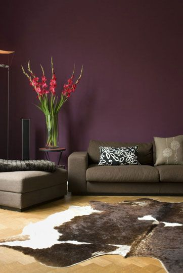 This IS THE color I want for the fireplace accent wall...AUBERGINE!  paired with neutrals and a cow hide rug...awesome!