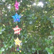 Hanging Christmas Star Decoration.  These colourful hanging decorations are made from recycled cardboard with metal links and sequin flowers. This bunting can be used indoors or outdoors. They come in their own box if you wish to keep them protected until your next event. Fair Trade. Length: 105cm. $12.00au