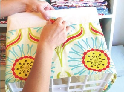 DIY fabric cover-up for a milk crate. A snazzy way to cover up your ugly crates or boxes!