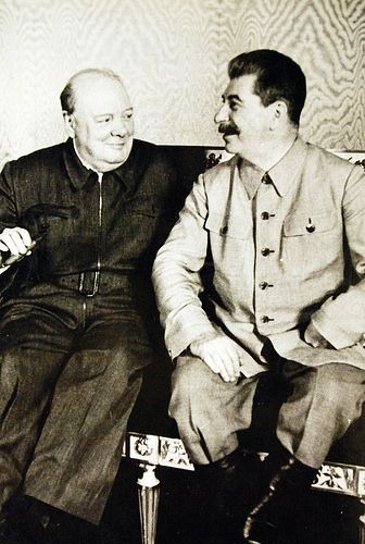 Lot 11596-2: Moscow Conference, August 12-17, 1942. Prime Minister of Great Britain Winston Churchill, (left), meets Soviet Premiere Joseph Stalin at the conference. Office of War Information Photograph.