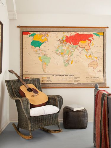 Use a pull-down map as colorful wall decor. #decorating
