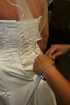 How to Fix a Wedding Dress to Hold Up the Train