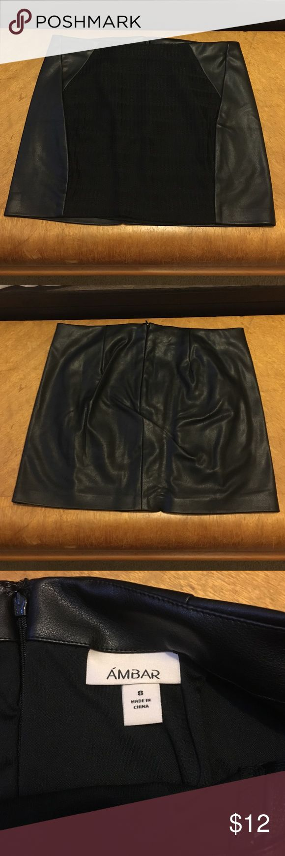 Black Mini Skirt Leather Look This mini skirt has a leather look to it a liner on the inside and a fabric front with a zipper back size 8 Ambar Ambar Skirts Mini