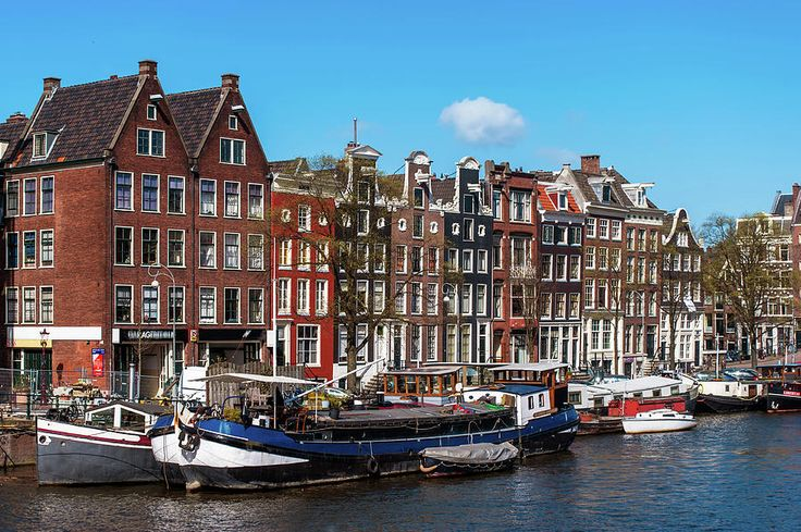 Typical Dutch Buildings In Amsterdam by Jenny Rainbow