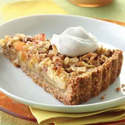 Fall desserts make good use of apples and this rich tart is no exception. Dried apricots and hazelnuts evoke flavors of fall, all wrapped up in a delicious vanilla wafer crust.