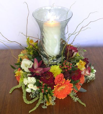 Fall Wreath Centerpiece Surrounds A Hurricane Lantern And Lighted Candle Fresh Flower
