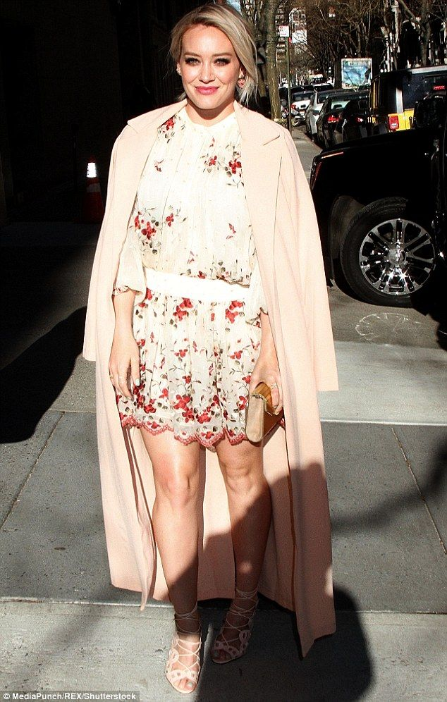Flower doll:Hilary Duff certainly knows how to look as fresh as spring when she wants to. The 28-year-old Younger star glowed in a floral dress as she headed out in New York City on Thursday