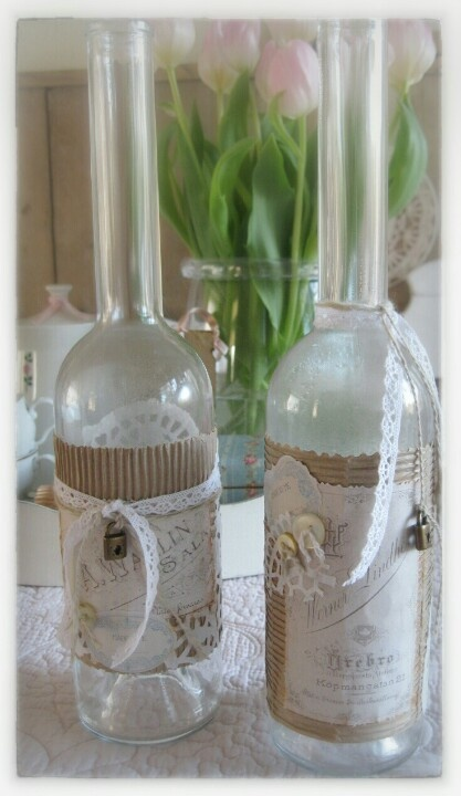 Decorate  an empty liquor bottle with some carbon paper, vintage paper, lace etc;  and this is the result ♡