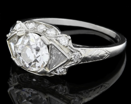 Platinum engagement rings from Jewellers Dublin with round cut diamond in the centre from Art Deco period