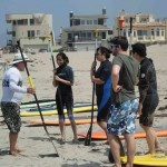 Learning to stand up paddle board near Ventura