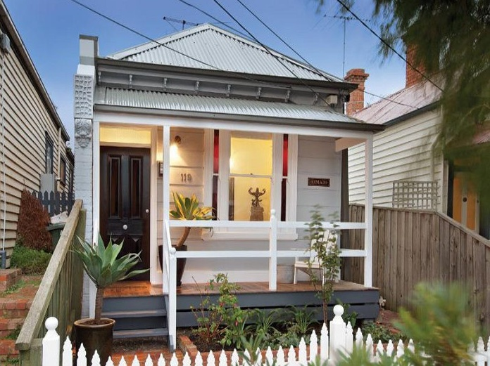 Weatherboard house with corrugated iron roof. Inner West.