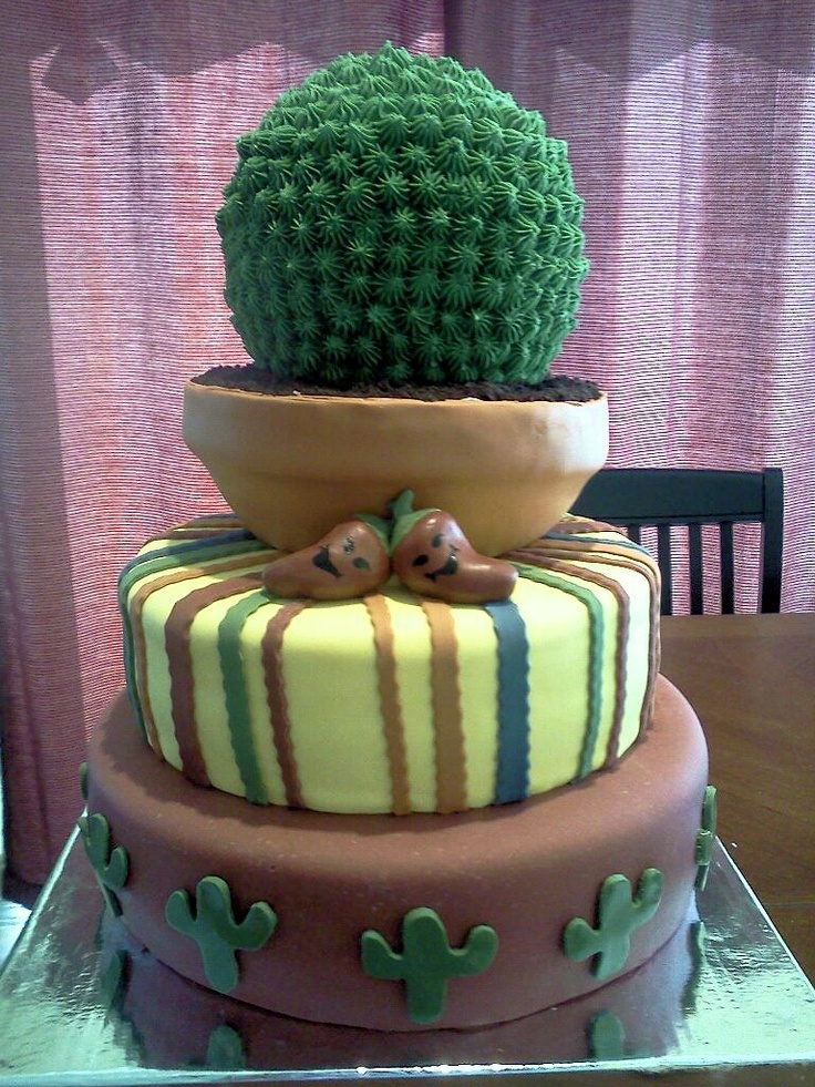 Cinco de Mayo  Dark Chocolate Cake  with Cookies and Cream Butter Cream.  Covered in fondant.  Cactus Bush made from Rice Krispie Treats.