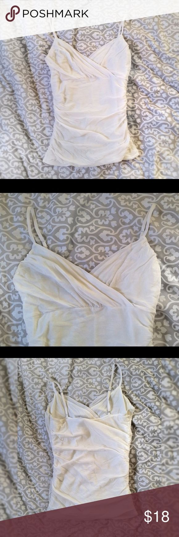 White Chiffon Camisole Beautiful, light cream colored v-neck, gathered tank top. Very elegantly sexy. Adjustable straps.Excellent condition apart from tag coming off and some paint coming off metal pieces (pictured).   Additional keywords: creme off-white offwhite eggshell blouse cami spaghetti strap sleeveless elegant feminine form-fitting fitted form fitting formfitting slim flattering romantic dressy date dinner party club night evening day transitional versatile H&M Tops Camisoles
