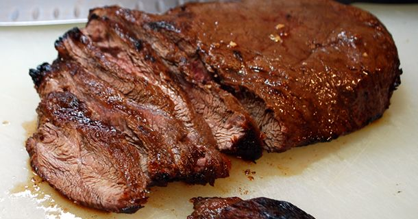 I am a huge fan of Flat Iron Steaks. What is a flat iron steak anyway? A flat iron steak is a relatively new cut of steak from the shoulder of a cow. It was discovered like all good discoveries,
