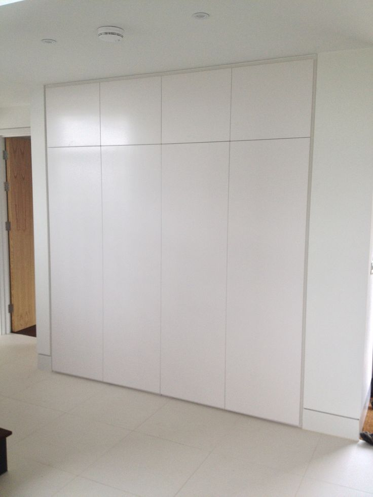 Built-in wardrobe space - Bespoke Design by Anthony Mullan furniture. Find out more at www.anthonymullan.com