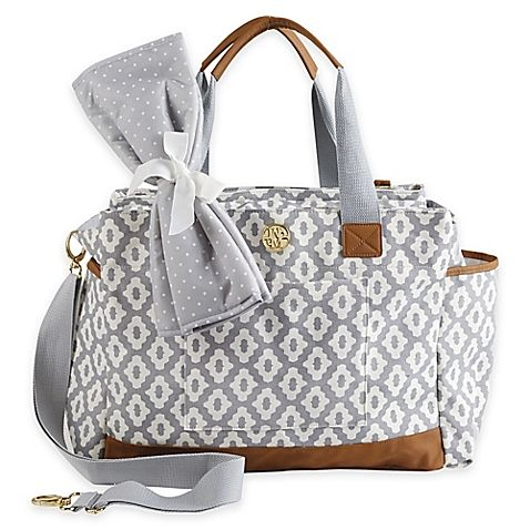 Easily tote your little one's essentials in style with the Bigger Bundle Geo Dot Diaper Bag from Mud Pie. A versatile carryon, this roomy accessory has the ultimate storage space and comes with a coordinating changing pad; perfect for all-day travels.