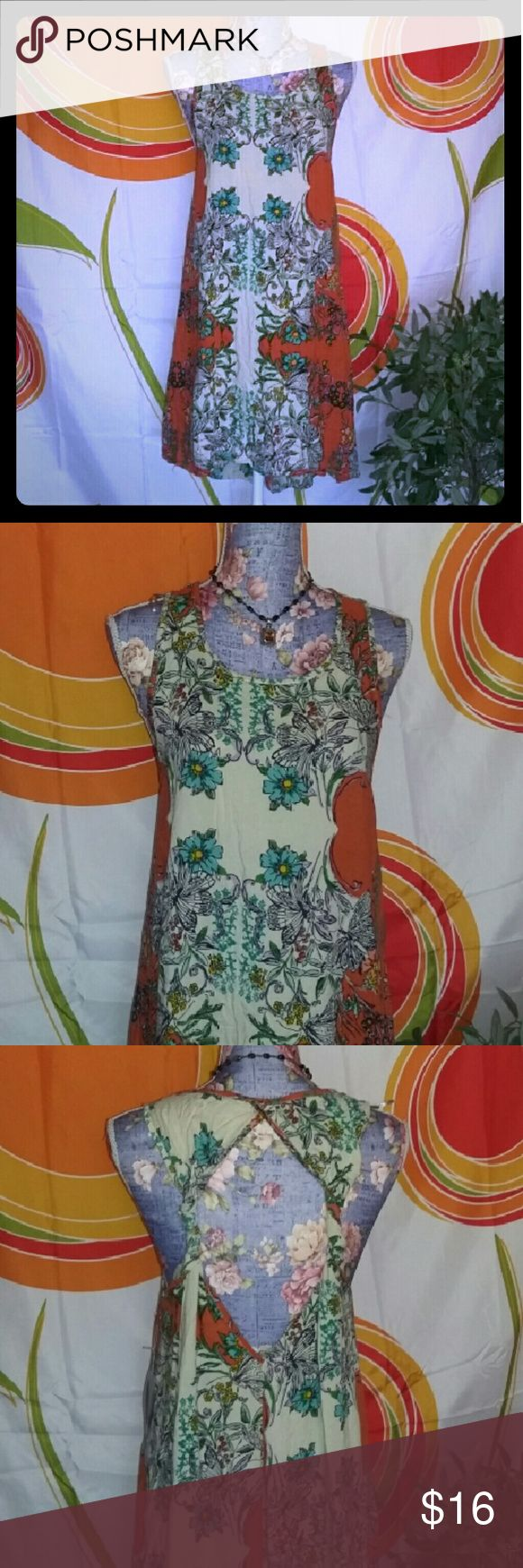 Floral Mini Dress or Cover Up NWT VERY CUTE Absolutely adorable mini dress and a size large by love 21. The material is 100% rayon. The design is a floral design with colors of orange blue green yellow pink turquoise black and cream. This could be used as a mini dress or even a swimsuit cover up. The back has a gorgeous diamond cut out please see the photograph. This is new with tags never been worn. Please message with any questions. Forever 21 Dresses Mini