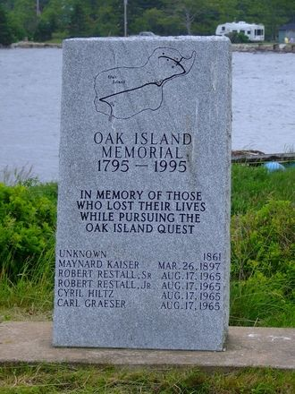 A memorial for 6 people who died while seeking the treasure on Oak Island. There is a rumor that there is a curse on the island and the island mysteries won't be unlocked until the 7th death.
