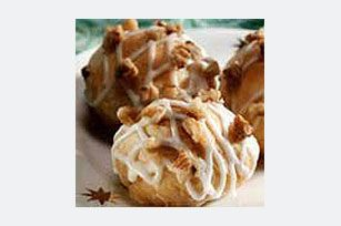 Marshmallow Puffs - Refrigerated crescent dough is wrapped around cinnamon-sugar-coated marshmallows then baked and drizzled with a glaze for a sweet treat. (You don't really need the glaze, or nuts they are great on their own)
