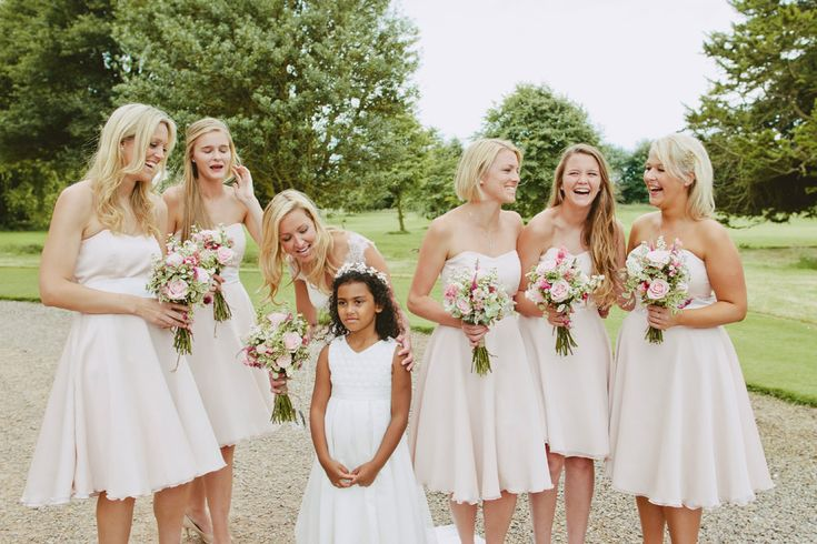 Pink Bridesmaid dresses from Maids to Measure with pink floral posies - Image by David Jenkins - Stephanie Allin Bride And Maids To Measure Bridesmaids For A Scottish Castle Wedding At Wedderburn Castle With Groom In Tartan Suit