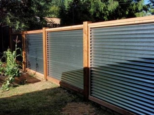 warm colored wood and corrugated metal for a privacy fence