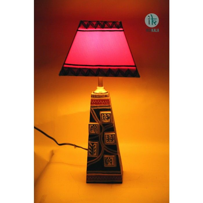 Black Wooden Warli Lamp with Red Shade Exquisite warli work on body of lamp gives it a classy ethnic look. The shade in Red combines well to complete the soft elegance. http://www.indikala.com/index.php/featured-products/terracota-black-warli-lamp-with-red-shade.html