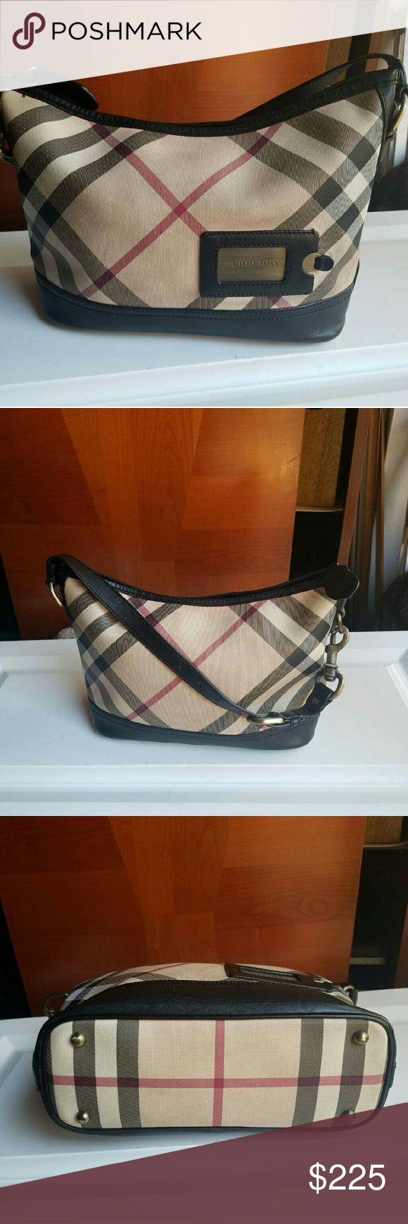 Burberry  hobo  purse model CNPANSIM1PAN. Authentic in good  condition. few minor stains of Wich I included pict of in last 2 photos burberry  metal anblem  Wich can be pulled out and serves as mirror  13 inch wide about 8 inch tall  6 inch handle drop this is a amazing deal for this brand &this purse  also  posted extra listing with additional  photos of friend mum posing with it  for visual  my listings are my items all authentic  this  is my purse purchased by me @ Burberry store on…