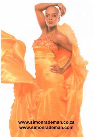 Noni Gasa proudly wearing Simon Rademan in FairLady magazine.
