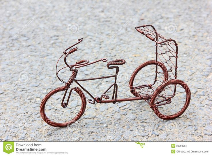 crafts made from copper | Toy crafts bicycle made of copper wire on the ground.