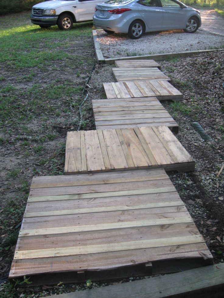 Wood Pallet Walkway  I cut out extra wood strips to fill in the spaces with fencing boards I slit up lengthwise.  I inserted 2x4 supports between the layers for support.  I plan to paint a grayed down whitewash on it and plant yellow mums on both sides in the fall.