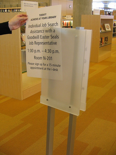 The Minneapolis library had beautiful signs that I thought were etched glass.  All were commercially available plastic pieces with vellum inserts - easy, economical way to really elevate signage in the library space.  (see? vellum., via Flickr.)