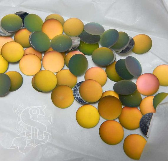 You will receive 3 cabochons. Color shifts from teal, green, yellow, orange, and sometimes pink, due to the artisanal nature of the item. They can be used for different purposes as fine handmade jewelry, and many others craft project! Please allow a minimum color differences due to different monitor settings from mine to yours! (¯`·.¸¸.-> °º Cabochon measurements: ø12mm º° <-.¸¸.·´¯)  .•°¤*(¯`★´¯)*¤°°¤*(¯´★`¯)*¤°•..•°¤*(¯`★´¯)*¤°°¤*(¯´★`¯)*¤°•..•°¤*(¯`★´¯)*¤°  *Shipping method informations…