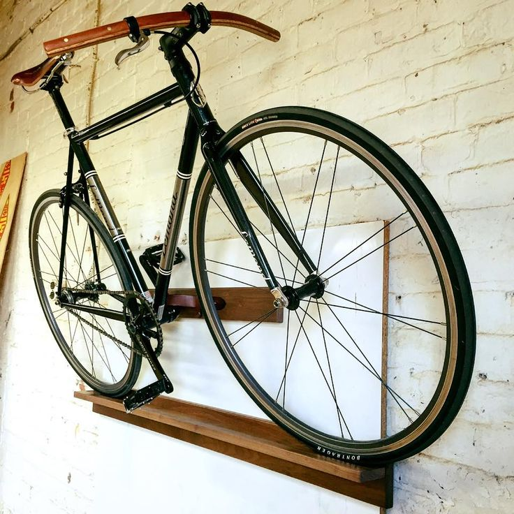 the perfect space saving bike mount for your apartment bicycle storage wall mounted desk. Black Bedroom Furniture Sets. Home Design Ideas