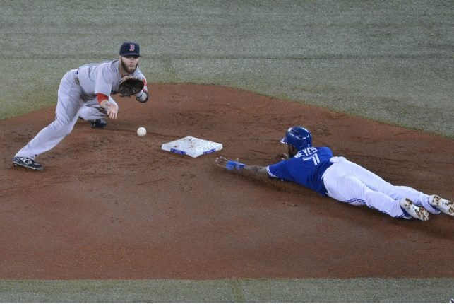Jose Reyes steals second while Dustin Pedroia waits for the ball in the 1st inning