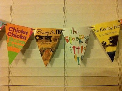 Banner using book jacket covers.  Great idea! & of course I just threw all of mine away!!!!