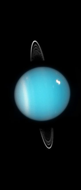 This image from the Hubble Space Telescope clearly shows the equatorial rings of Uranus, a southern cloud deck and a bright cloud in the northern hemisphere. Uranus is unique in that its axis is tilted to align with the solar system elliptic plane.