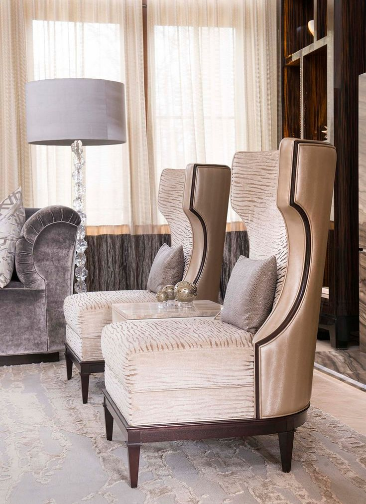 luxury lounge area with wingback chairs ddginteriors 78151