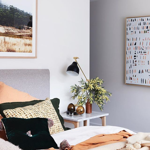 Bedroom details // 100 Broadway, Elwood. Our Matilda bed, Woodrow bedside table, layers of Bedouin Societe linen, the Tassel Squab cushion by @elisecakebread and artwork by @carlywilliamsart & @kararosenlund. Shop online or in store. We are open from 11 - 5 today. . See the full property over on the blog ☝🏼 . #fentonandfenton #propertystylingmelbourne #styling #bedroomstyling #carlywilliamsart #woodrowrange #kararosenlund #bedouinsociete 📷 @evegwilson