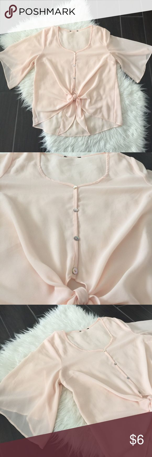Women's tie front shirt. Pink tie up shirt. Good used condition womens blush pink with a hint of peach tie up shirt. No tags, from TJmaxx. Size medium. No low ball offers or trades. Please ask any questions and review photos for details and wear. TjMaxx Tops Blouses