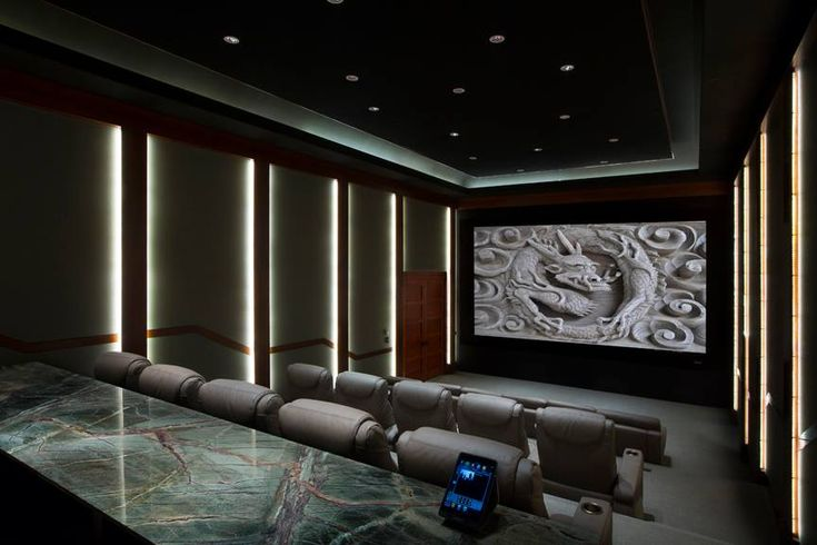 Contemporary Home Theater with interesting lighting solution...