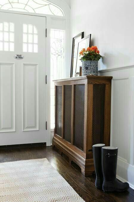 Contrasting wood is nice with the white :: Havens South Designs :: Radiator cover in the entry