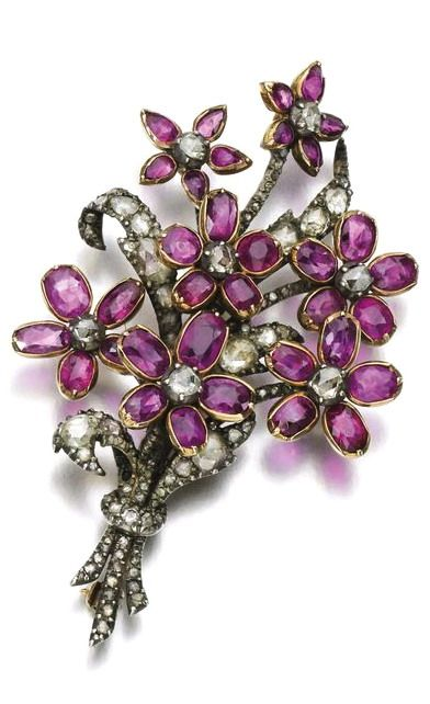 Ruby and diamond brooch, early 19th century. Of bouquet design, set with oval rubies and rose diamonds.