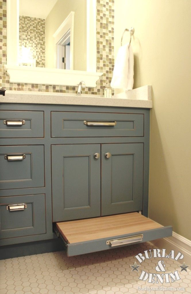 Love the paint color on this bathroom vanity with pull out drawer stool. Click through to see pictures of the whole bathroom!