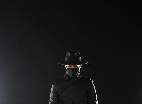 fedora + black mask + strapped trench coat