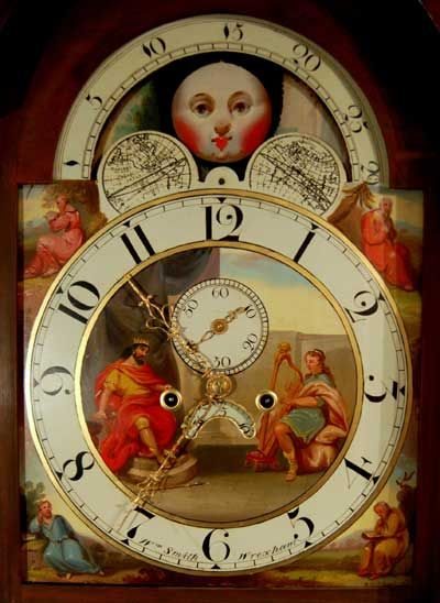 AN EXCEPTIONAL ROLLING MOON ANTIQUE GRANDFATHER CLOCK LONGCASE CLOCK     BY WILLIAM SMITH OF WREXHAM    THE BEAUTIFUL DIAL WITH MOON PHASE WITH SEA AND LANSCAPE ON EITHER SIDES OF THE MOONS, A PAINTING OF KING DAVID AND HIS HARP TO THE CENTRE, SUBSIDIARY SECONDS HAND AND DATE APPERTURE, ARABIC NUMERALS. WITH ORIGINAL FOUR- PILLAR MOVEMENT STRIKES THE HOUR ON A BELL. Circa 1815