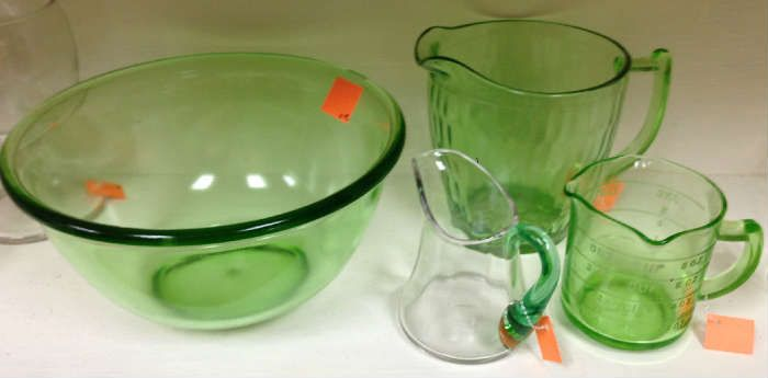 Found on EstateSales.NET: Green Depression glass. The green measuring cup is just like Granny's.