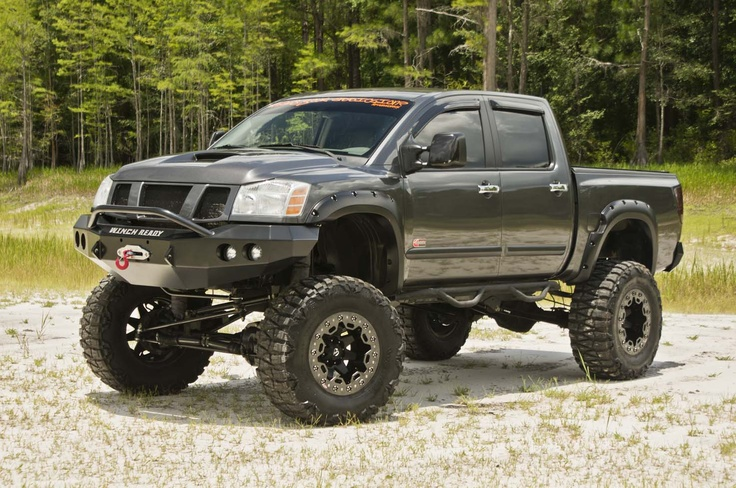 Lifted Nissan with an attitude! Now that's a Man's Truck #MonsterRide
