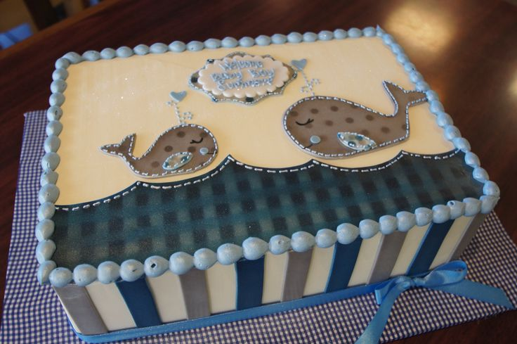 Invitation matching baby shower sheet cake with cute whale design