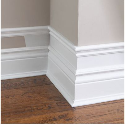 Create an Exaggerated Baseboard. Cool idea for adding height to existing baseboard